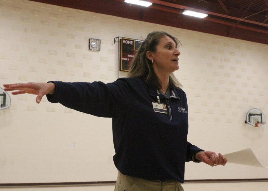 Steph Howie, a group fitness specialist at the Center for Health Improvement, presents to students on Oct. 30.