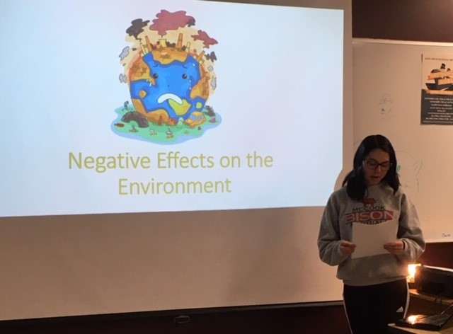 Environmental Club President Kamryn Schoenberger presents to the Environmental Club after school on Nov. 15. Schoenberger discussed negative impacts on the environment as well as things consumers can do to mitigate those impacts.