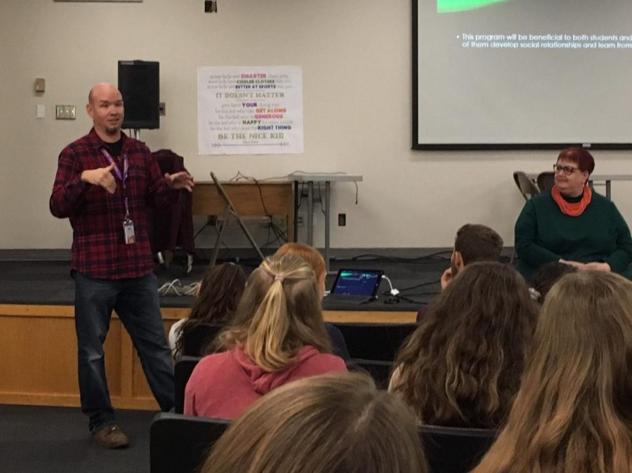 Senior Pen Pals sponsor Luke Lundmark (left) discusses the goals of the Pen Pal program during the information meeting held during PRIDE Time on Nov. 15