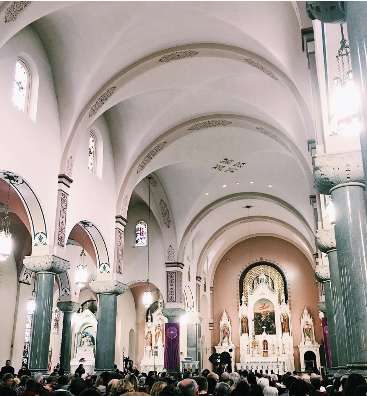 Audience members pack the Basilica of St. Fidelis before the start of the concert. The Basilica is commonly referred to as
