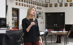 During PRIDE Time, Holly Latham talks to students about being a Kansas Bureau of Investigation the Vocal Room. Latham worked as a KBI Forensics Specialist for 20 years.