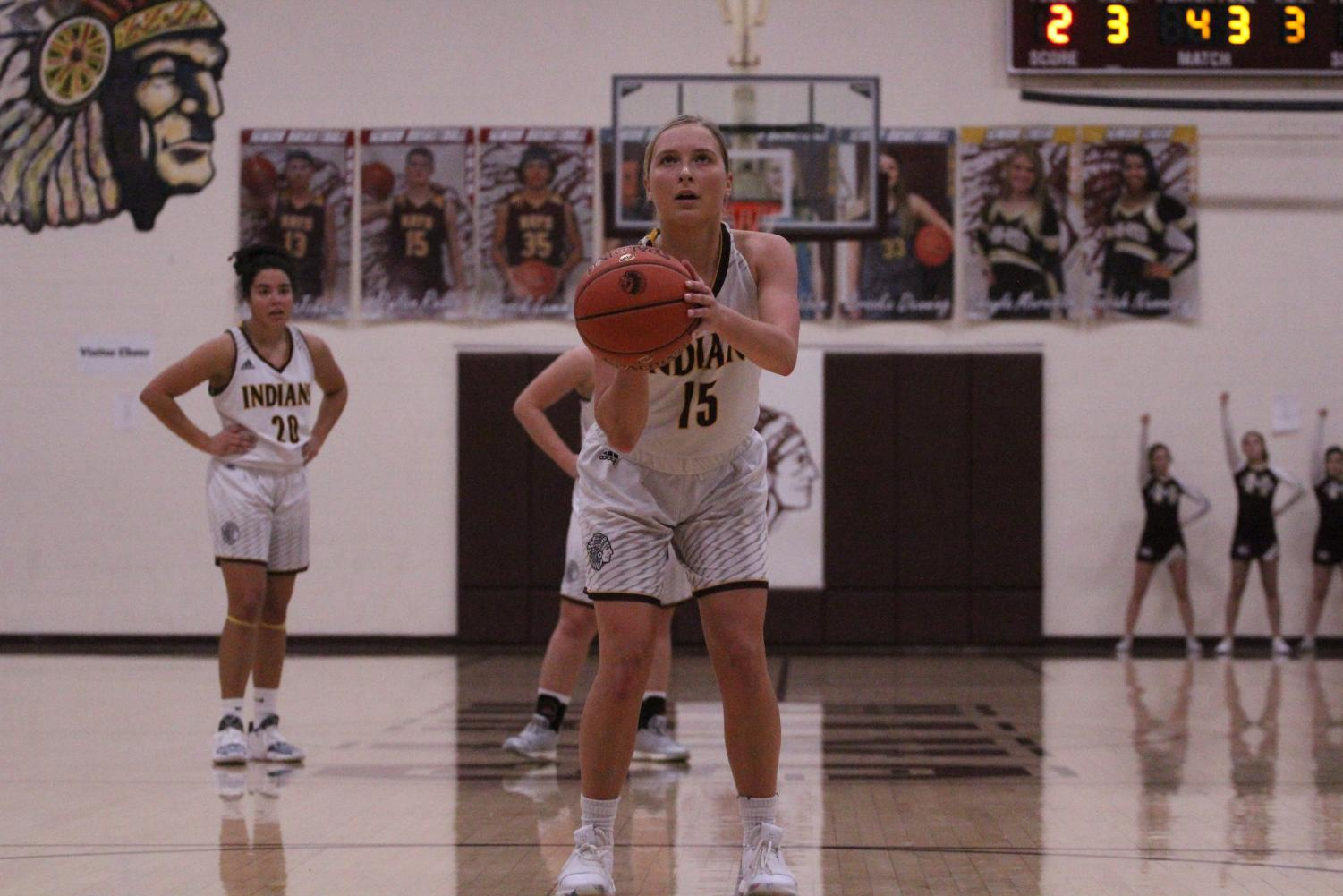 Junior Brooklyn Schaffer shoots a free throw in a home game during the Shootout in December.
