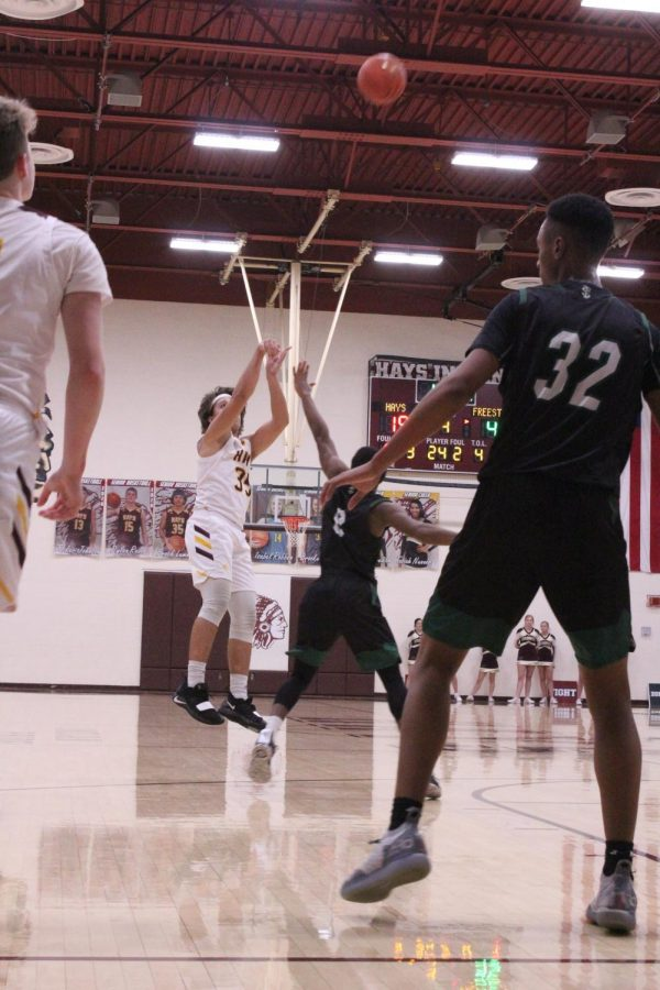 Senior Brock Lummus shoots a three pointer during the Shootout tournament that Hays hosted in December.