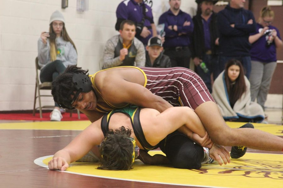 Senior Da'Vontai Robinson pins his opponent during his first match on Saturday.