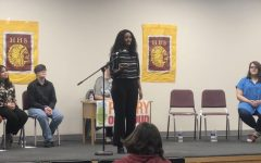 Senior places first at school-wide Poetry Out Loud competition