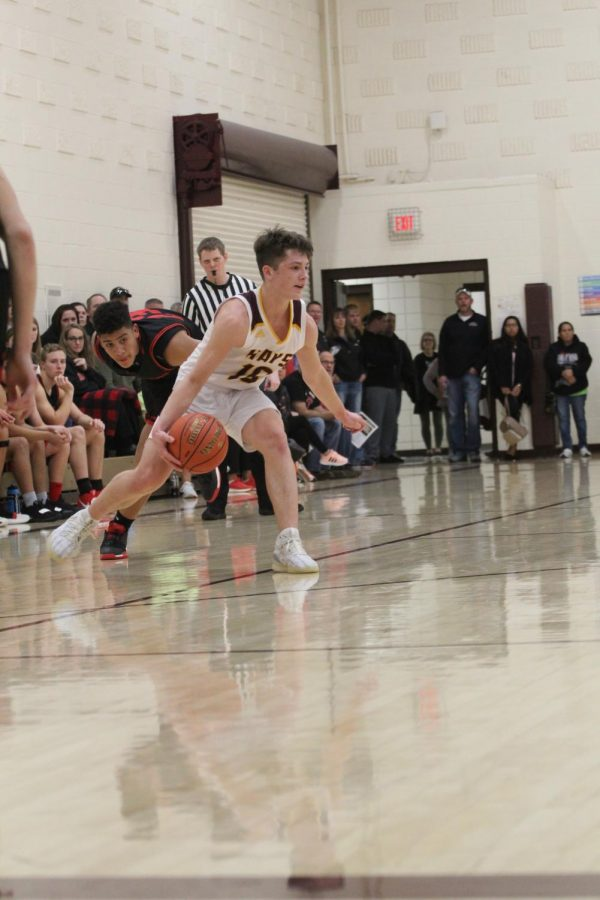 Sophomore Noah Weimer dribbles the ball during the home game against Great Bend on Jan. 14.