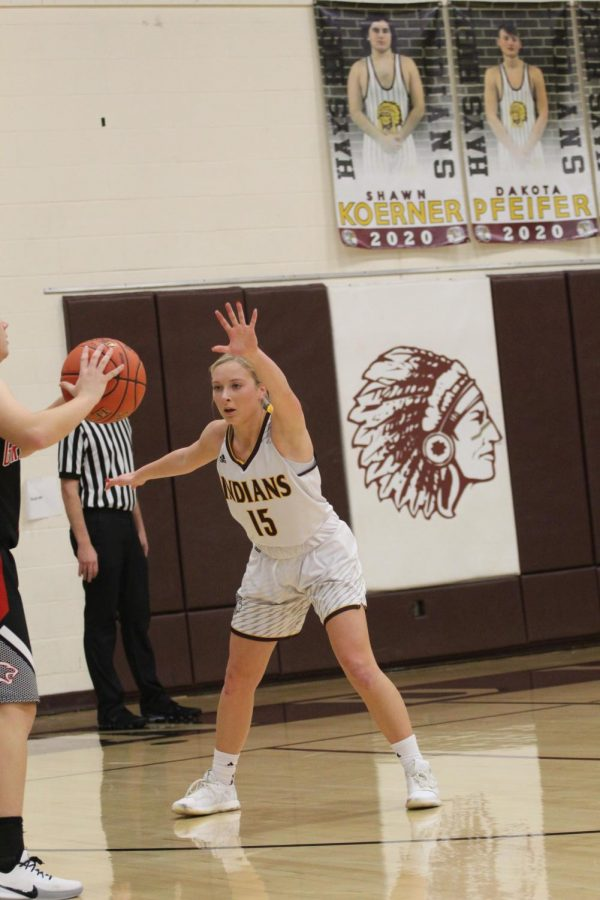 Junior Brooklyn Schaffer plays defense during the home game against Great Bend on Jan. 14.