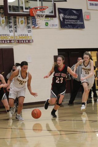 Senior Tasiah Nunnery and sophomore Aleyia Ruder get the ball back from Great Bend during the home game on Jan. 14.
