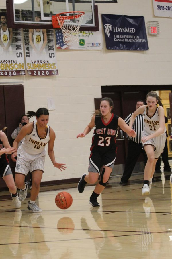 Senior+Tasiah+Nunnery+and+sophomore+Aleyia+Ruder+get+the+ball+back+from+Great+Bend+during+the+home+game+on+Jan.+14.+