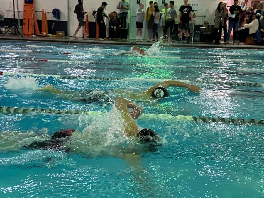 Freshman+Jude+Tippy+and+Kaden+McBride+participate+in+their+relays.