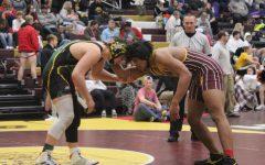 Senior Davontai Robinson wrestles at the Bob Kuhn Tournament on Jan. 25 at Hays High.