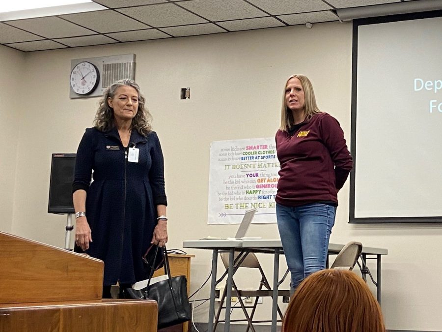Instructor Jennifer Younger (right) introduces FHSU Art and Design professor Lisa Ganstrom (left) during the Art Club meeting on Feb.4. Ganstrom talked to students about the opportunities for art students at Fort Hays State University and showed pictures of the new art building on campus.