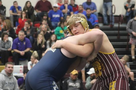 Sophomore Gavin Nutting wrestles at the Bob Kuhn Tournament on Jan. 25 at Hays High. At state, Nutting finished in fifth place in his weight division.