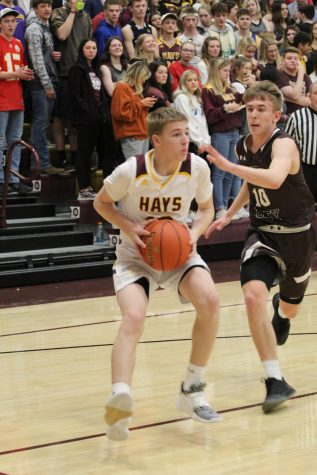 Boys basketball heads to state tournament with win over Great Bend