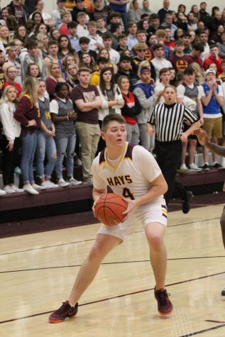 Sophomore Carson Kieffer looks for one his teammates to pass to during the home game on Feb. 21.
