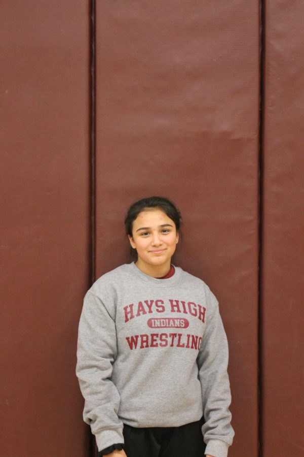 Freshman Sarah Zimmerman poses for the individual pictures taken of each wrestler.