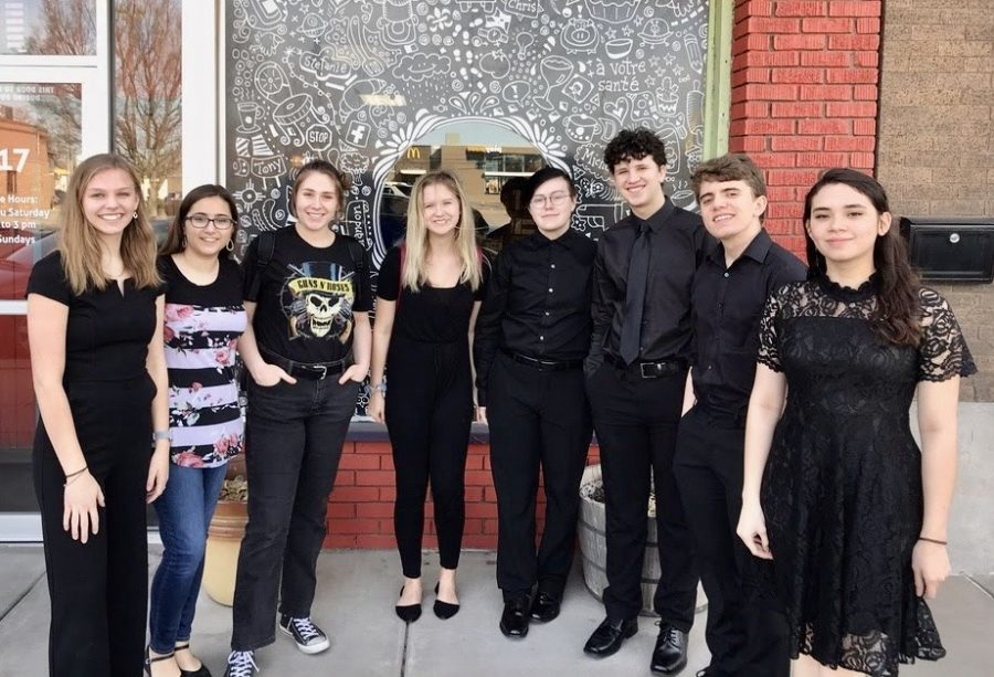 The students from the Treble and Mixed choirs pose in front of La Galette French Bakery after their concert [freshman Devlyn Jochum and junior Alexis White not pictured]. Each choir featured 256 students from across the state.