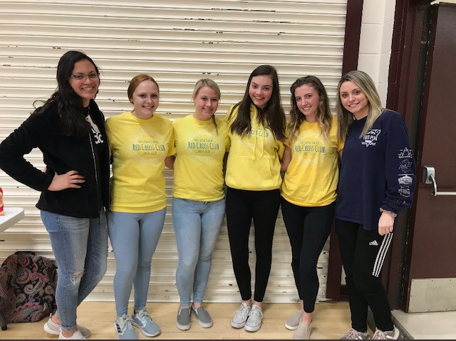 Red Cross Club officers pose for a picture during the Blood Drive on March 5. Officers volunteered for the entirety of the drive along with instructor Erin Deenihan.