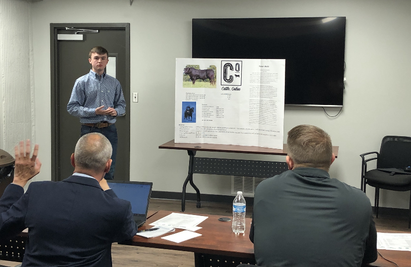 Freshman+Tanner+Werth+presents+his+company+Cattle.Online+to+panel+of+judges+during+the+2020+Ellis+County+Youth+Entrepreneur+Challenge.+Twenty-five+students+competed+in+the+event.