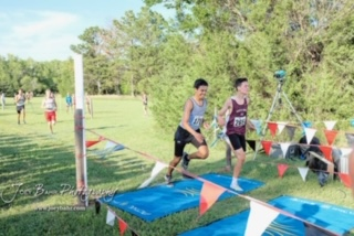 Sophmore Landon Viegra races at the Great Bend Invitational Meet on August 30, 2019, before the COVID-19 outbreak. Cross Country is one of his motives for staying in shape during quaratine.
