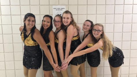 The Dance Team girls pose for a picture as they wait for their team pictures to be taken.