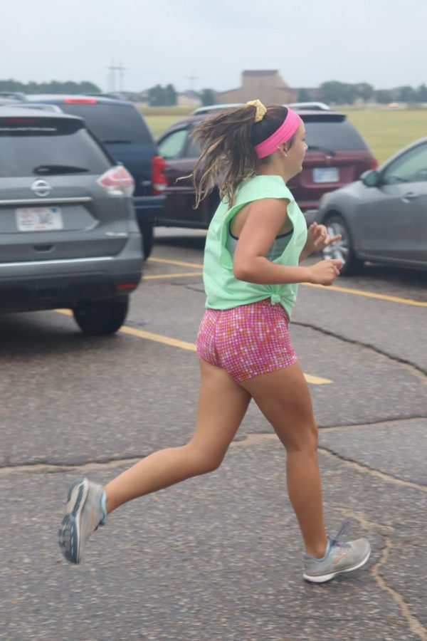 Sophomore Ashlyn Hammerschmidt runs toward the finish line at the end of the mock meet.