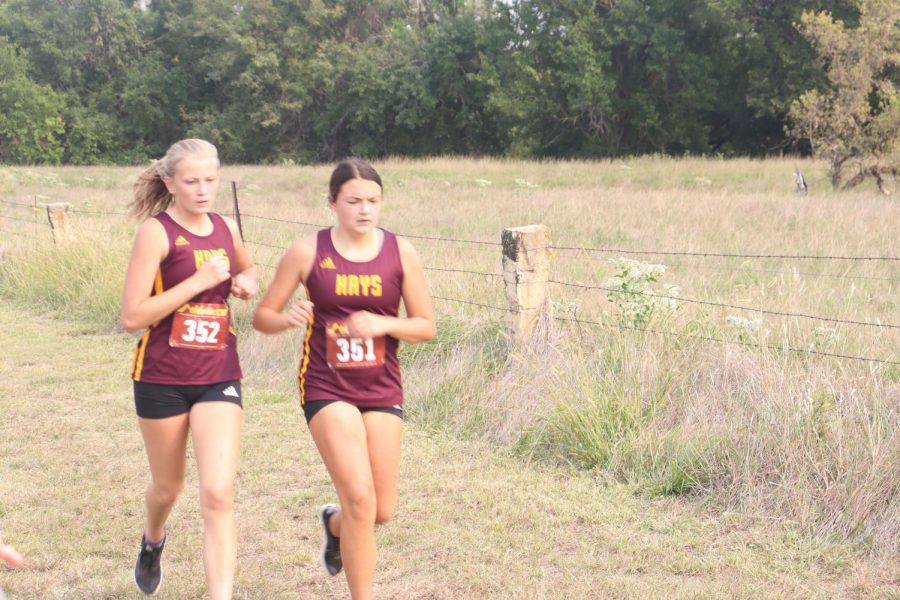 Junior Lainey Hardman and sophmore Ashlyn Hammerschmidt compete in the JV race.