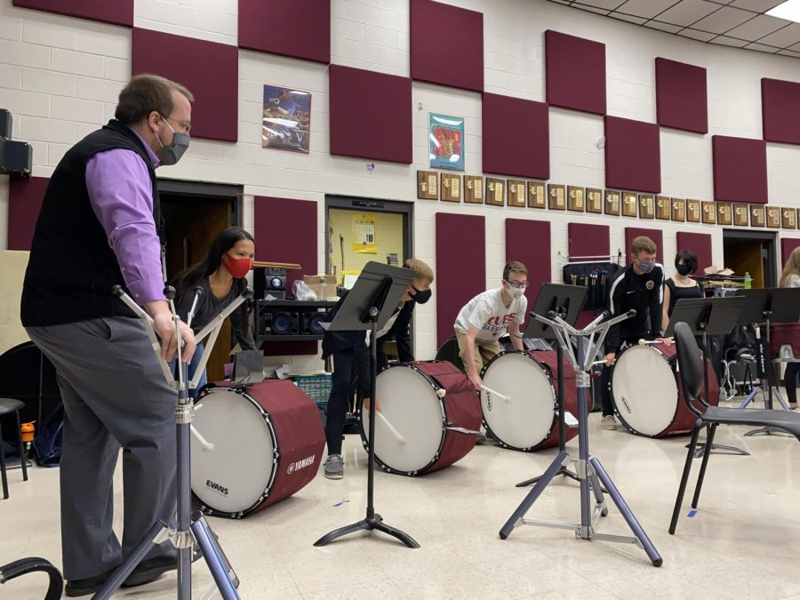 Band director Matthew Rome leads the bass drums through a difficult section in their rehearsal time during M1. Without the commitment of any marching festivals, the students will have the freedom to vary their music throughout the season.