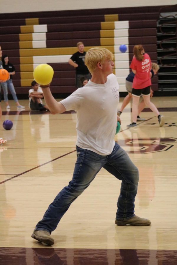Junior+Kyle+Mortensen+throws+the+yellow+dodgeball+during+the+team+building+activity.+