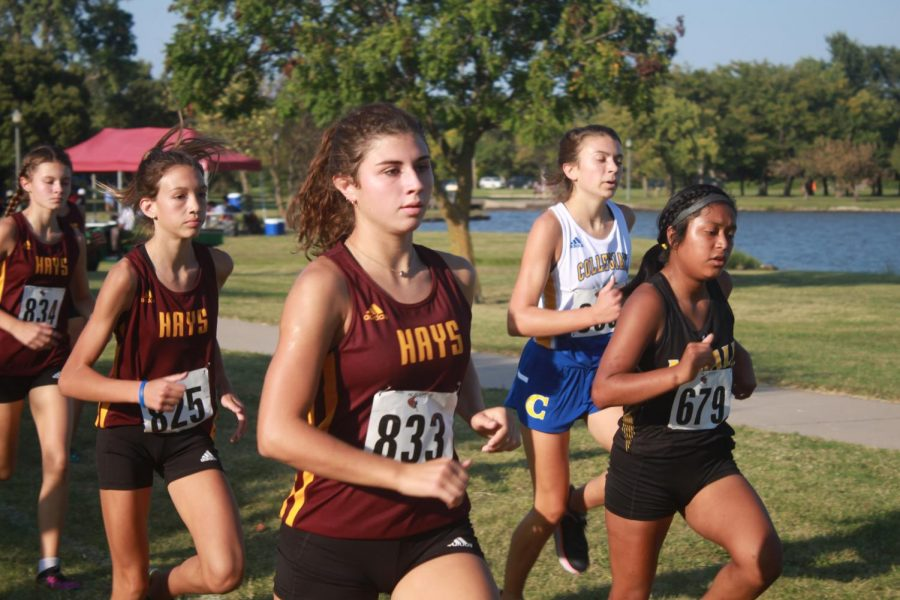 Sophomore Amelia Jaeger and freshmen Brenlynn Alber and Brynn Kinderknecht compete in the varsity race.