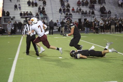 Junior wide receiver/ quarterback Jaren Kanak out runs opponents to find the endzone on October 16th at Maize South.