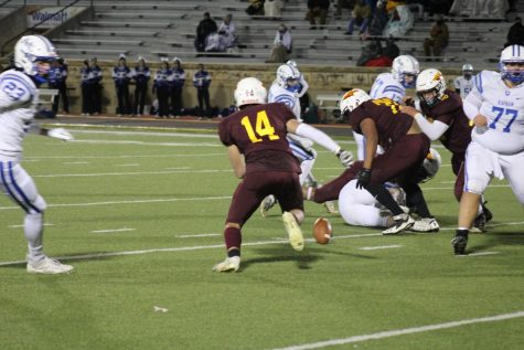 Senior Bill Scott runs towards the loose ball giving the Indians offense a chance for an extra possession against Kapaun Mt. Carmel on October 23.