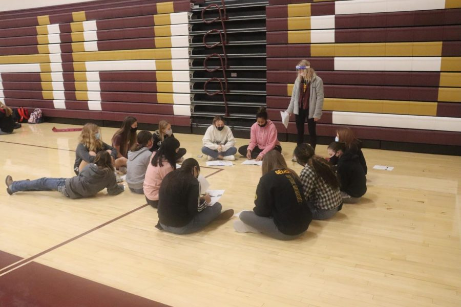 Junior Ashlynn Flax talks to her group of freshmen about why their grades and attendance rates matter during the meeting on Nov. 18.