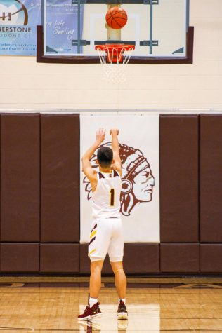 Senior Jason Krannawitter shoots a free throw vs cross town rival TMP.