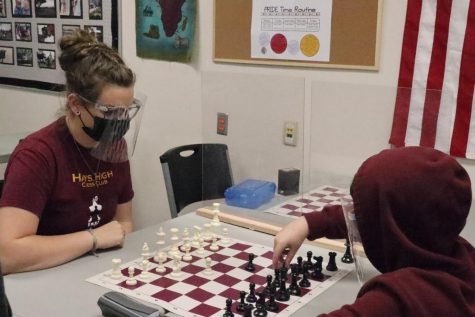 Sixth grader Kamden McBride practices with sponsor Erin Holder. McBride attends Chess Club meetings and meets up with the club to compete online.