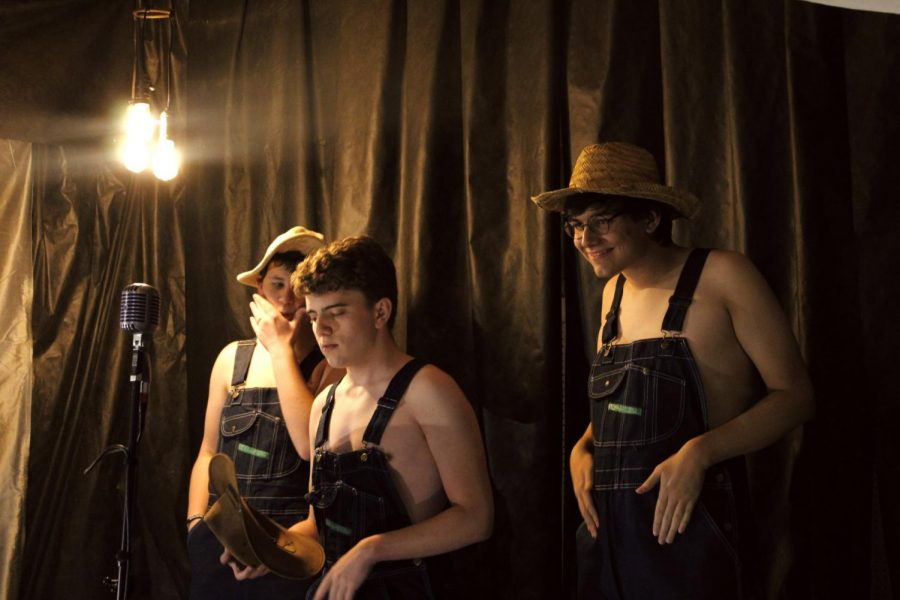 Seniors Gabe McGuire, Tom Drabkin, and Andrew Duke (left to right) line up in their order as the opening act in the 2021 Cabaret. The trio performed