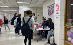 StuCo officers and members sell candy grams to students in the gym commons area.