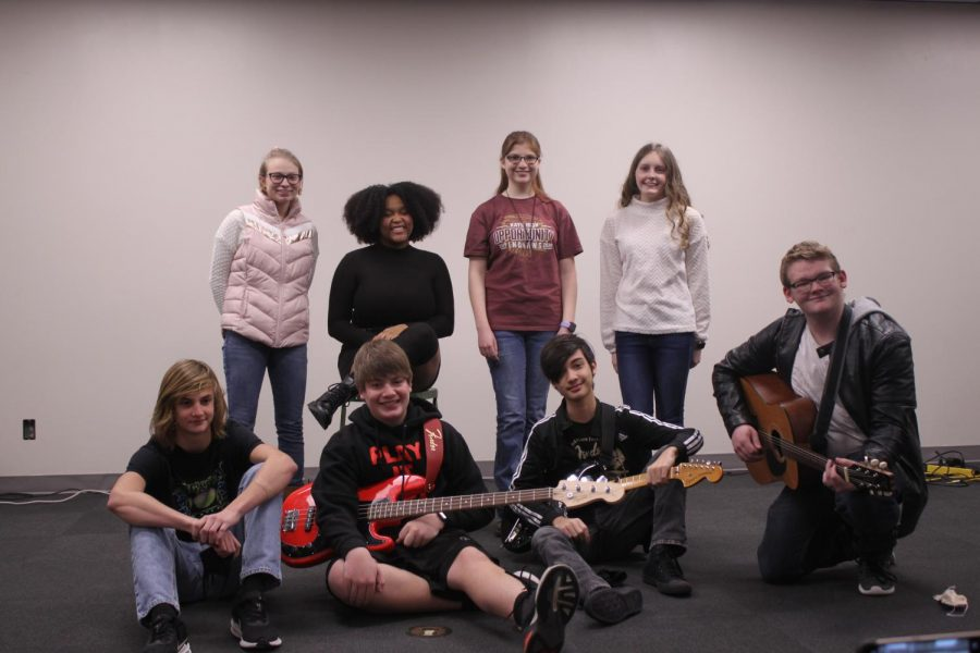 The seven acts pose for a group photo after their talent show performances in the Lecture Hall.