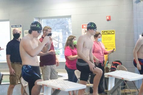 Sophomore Grayson Walburn prepares for a race at the Center for Health Improvement during the Hays swim meet.