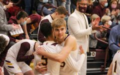 Seniors Dalyn Schwartz and Tj Nunnery embrace each other as they celebrate a win on senior night.
