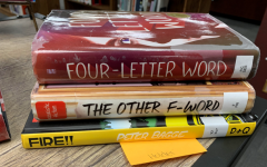 The Library is holding a poetry contest. The categories are Blackout poetry and Spine poetry. This is one example of Spine poetry. It reads: