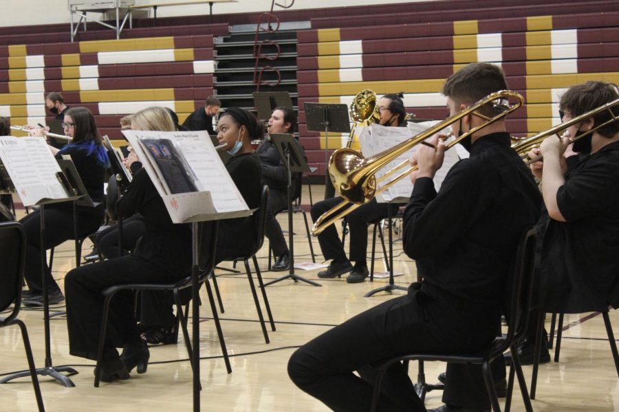 Members of the band perform during one of their few concerts this school year due to the pandemic. They have had to be more careful about practicing and being around one another, also due to the pandemic.
