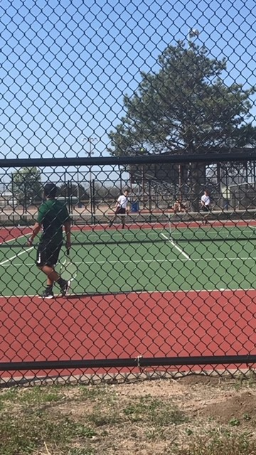 The varsity and junior varsity boys tennis team competes in Abilene and Great Bend.
