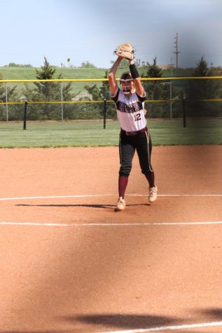 Freshman Aubree Thomas starts her pitching motion during the home game against Colby on May 6.