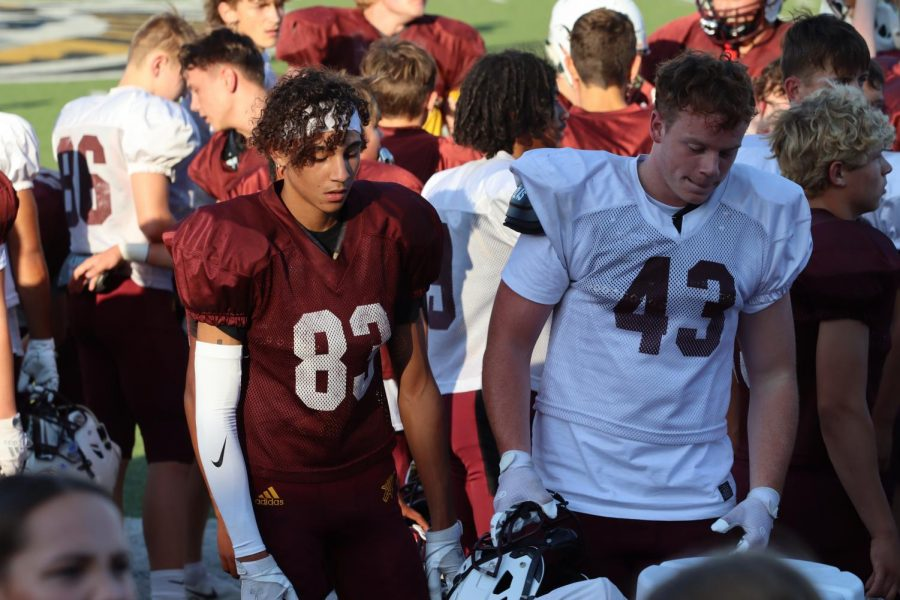 Juniors Deondre Broom and Bryce Salmans discuss their next play during the scrimmage. The Indians would pick up a road win in Liberal and improve their record to 3-0.