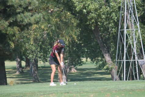 Sophomore Ashlynn Banker putts on hole one at the Smoky Hill Country Club.