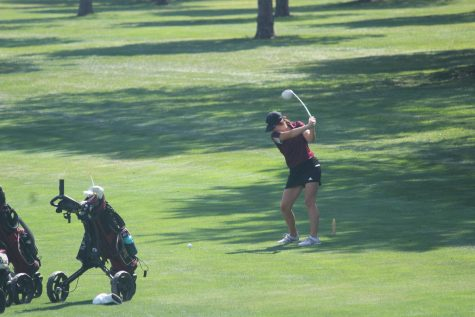 Junior Aspen Melvin hits her tee shot on hole 2 at the HHS golf tournament.
