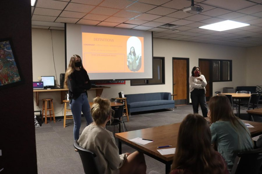 Freshmen listen to Janas Campaign representatives present about dating violence in the library on Sept. 21 and 22.
