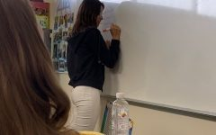 Sophomore Joey Cooper writes down what students will bring for Mexican Independence day.