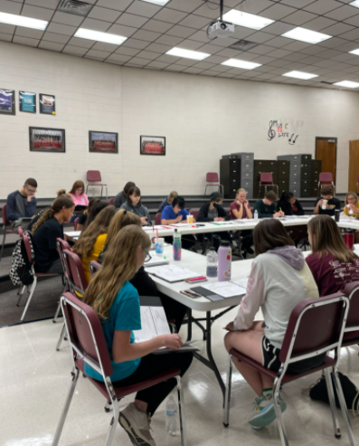 The cast of the fall musical, Urinetown, rehearses in the Hays High Choir room on Sept. 14.